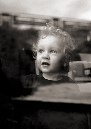 Boy watches train through window